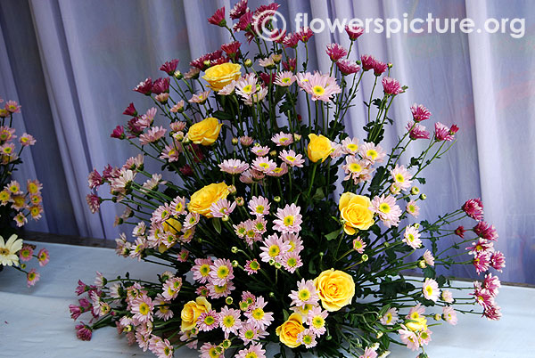 Pink chrysanthemum and yellow rose bouquet